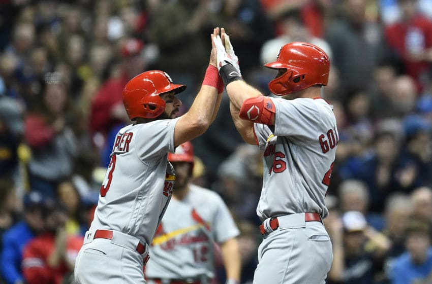 MILWAUKEE, WISCONSIN - MARCH 29: Paul Goldschmidt #46 celebrates a two run home run with Matt Carpenter #13 of the St. Louis Cardinals during the first inning of a game against the Milwaukee Brewers at Miller Park on March 29, 2019 in Milwaukee, Wisconsin. (Photo by Stacy Revere/Getty Images)