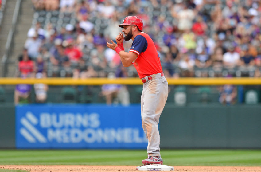 DENVER, CO - AUGUST 26: Matt Carpenter #13 of the St. Louis Cardinals celebrates and acts like he's eating salsa after reaching second base on a seventh inning double for his fourth double of the game against the Colorado Rockies at Coors Field on August 26, 2018 in Denver, Colorado. Players are wearing special jerseys with their nicknames on them during Players' Weekend. (Photo by Dustin Bradford/Getty Images)