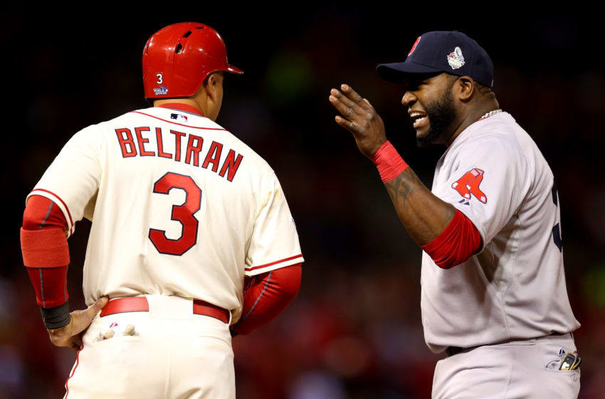 ST LOUIS, MO - OCTOBER 26: David Ortiz #34 of the Boston Red Sox talks to Carlos Beltran #3 of the St. Louis Cardinals in the seventh inning of Game Three of the 2013 World Series at Busch Stadium on October 26, 2013 in St Louis, Missouri. (Photo by Ronald Martinez/Getty Images)