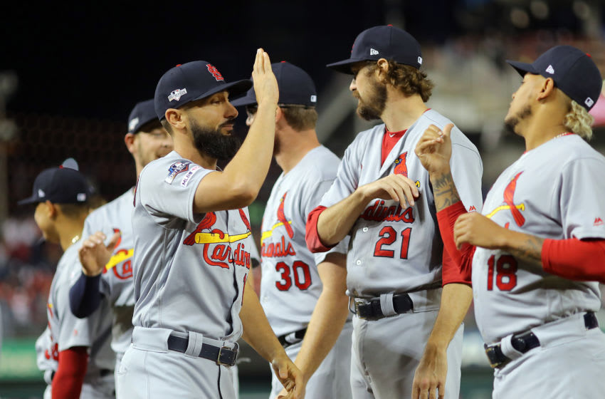WASHINGTON, DC - OCTOBER 14: Matt Carpenter #13 of the St. Louis Cardinals greets his teammates during introductions before Game 3 of the NLCS between the St. Louis Cardinals and the Washington Nationals at Nationals Park on Monday, October 14, 2019 in Washington, District of Columbia. (Photo by Alex Trautwig/MLB Photos via Getty Images)