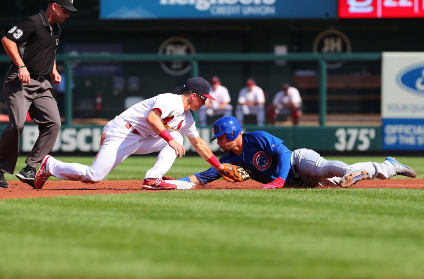 ST LOUIS, MO - SEPTEMBER 29: Willson Contreras #40 of the Chicago Cubs is thrown out at second base against Paul DeJong #12 of the St. Louis Cardinals in the second inning at Busch Stadium on September 29, 2019 in St Louis, Missouri. (Photo by Dilip Vishwanat/Getty Images)
