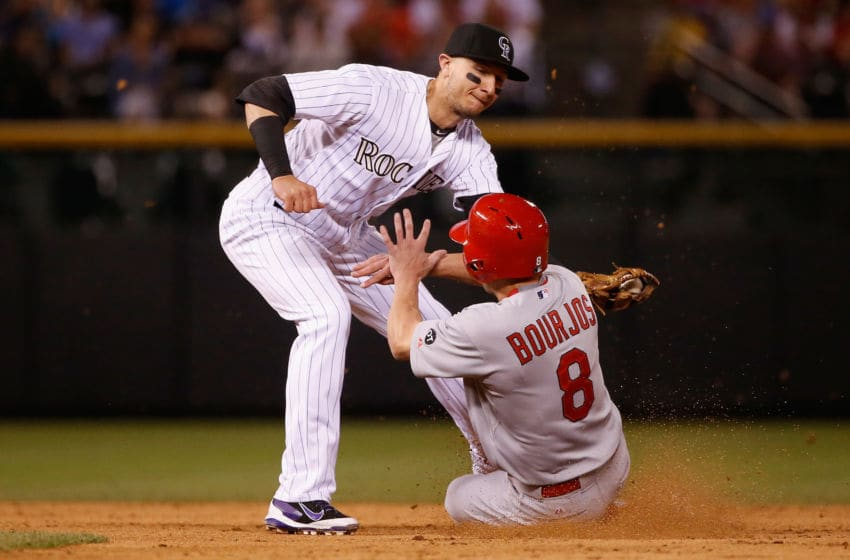 DENVER, CO - JUNE 09: Peter Bourjos #8 of the St. Louis Cardinals is caught stealing second base as shortstop Troy Tulowitzki #2 of the Colorado Rockies makes the tag in the fifth inning at Coors Field on June 9, 2015 in Denver, Colorado. (Photo by Doug Pensinger/Getty Images)