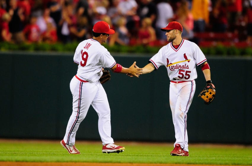 ST. LOUIS, MO - AUGUST 26: Jon Jay #19 and Skip Schumaker #55 of the St. Louis Cardinals celebrate after defeating the Pittsburgh Pirates at Busch Stadium on August 26, 2011 in St. Louis, Missouri. (Photo by Jeff Curry/Getty Images)