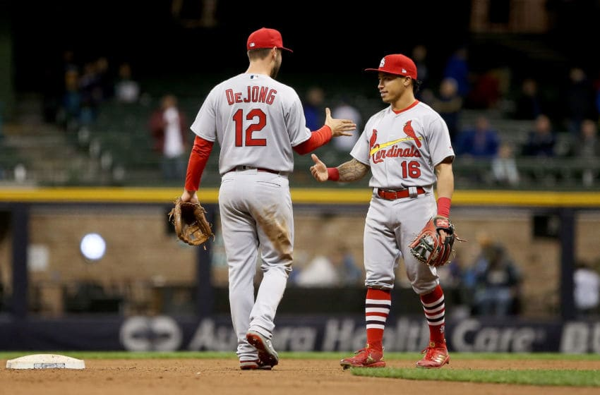 MILWAUKEE, WI - APRIL 04: Paul DeJong #12 and Kolten Wong #16 of the St. Louis Cardinals celebrate after beating the Milwaukee Brewers 6-0 at Miller Park on April 4, 2018 in Milwaukee, Wisconsin. (Photo by Dylan Buell/Getty Images)