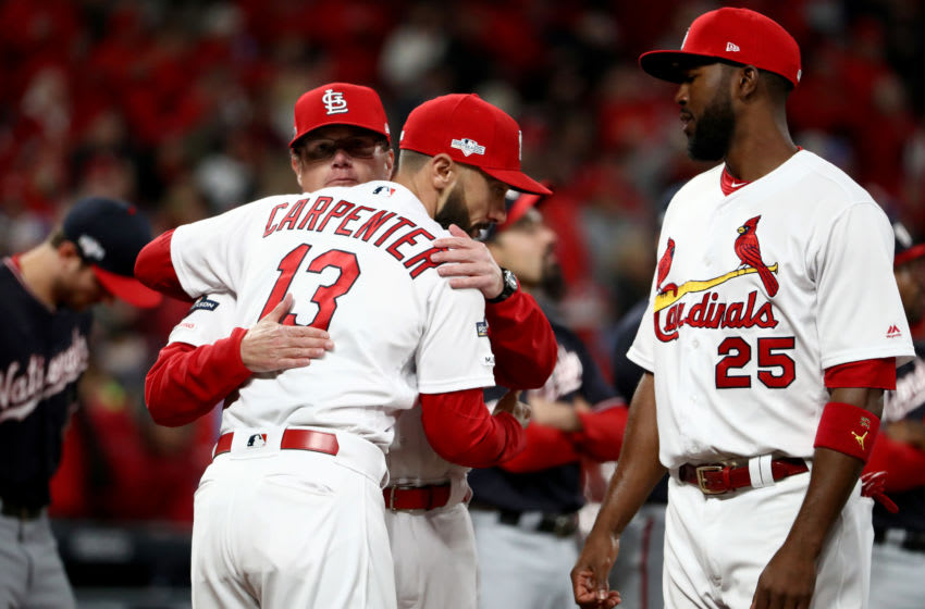 ST LOUIS, MISSOURI - OCTOBER 11: Mike Shildt #8 of the St. Louis Cardinals hugs Matt Carpenter #13 as Dexter Fowler #25 looks on prior to game one of the National League Championship Series against the Washington Nationals at Busch Stadium on October 11, 2019 in St Louis, Missouri. (Photo by Jamie Squire/Getty Images)