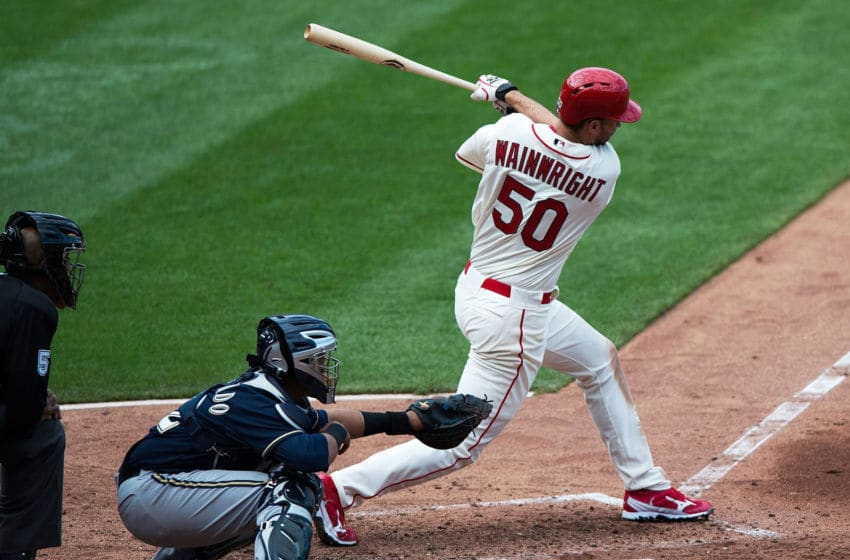 ST. LOUIS, MO - APRIL 13: Adam Wainwright #50 of the St. Louis Cardinals hits a one run single during the sixth inning against the Milwaukee Brewers at Busch Stadium on April 13, 2013 in St. Louis, Missouri. (Photo by Jeff Curry/Getty Images)
