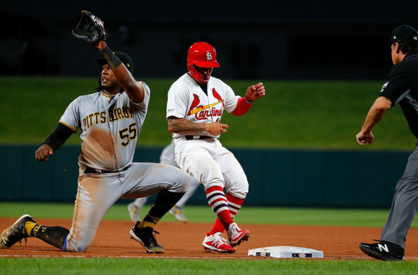 ST LOUIS, MO - AUGUST 09: Kolten Wong #16 of the St. Louis Cardinals beats the throw back to Josh Bell #55 of the Pittsburgh Pirates in the seventh inning at Busch Stadium on August 9, 2019 in St Louis, Missouri. (Photo by Dilip Vishwanat/Getty Images)