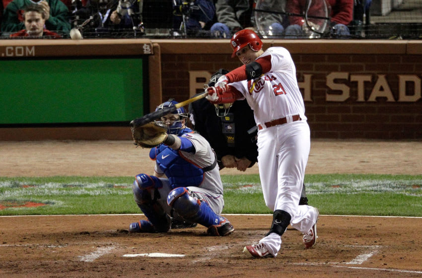 ST LOUIS, MO - OCTOBER 28: Allen Craig #21 of the St. Louis Cardinals hits a solo home run in the third inning during Game Seven of the MLB World Series against the Texas Rangers at Busch Stadium on October 28, 2011 in St Louis, Missouri. (Photo by Rob Carr/Getty Images)