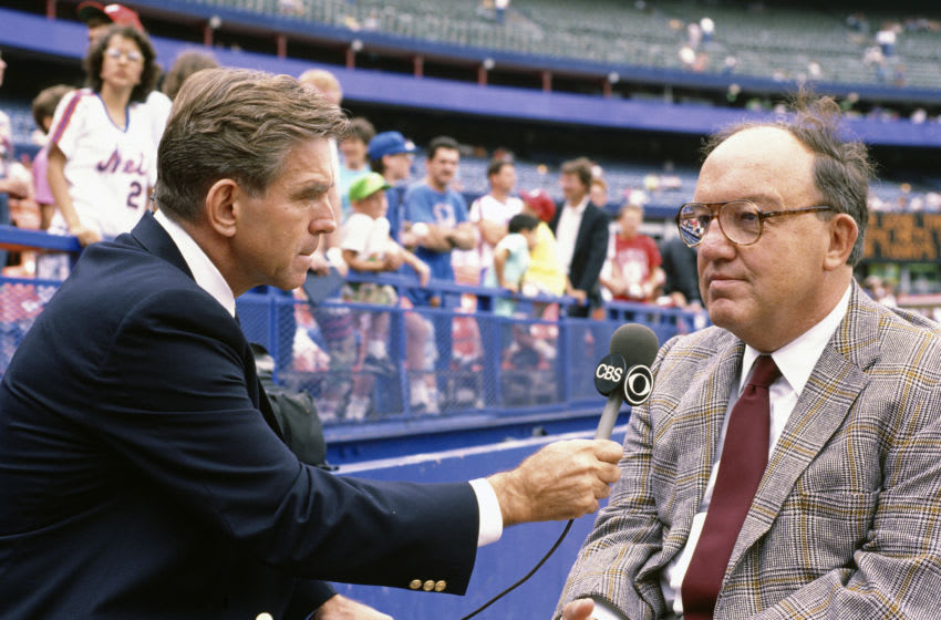 NEW YORK - CIRCA 1990: ABC broadcaster and former baseball player Tim McCarver talks with Commissioner Fay Vincent prior to the start of a Major League Baseball game circa 1990 at Shea Stadium in the Queens borough of New York City. (Photo by Focus on Sport/Getty Images)