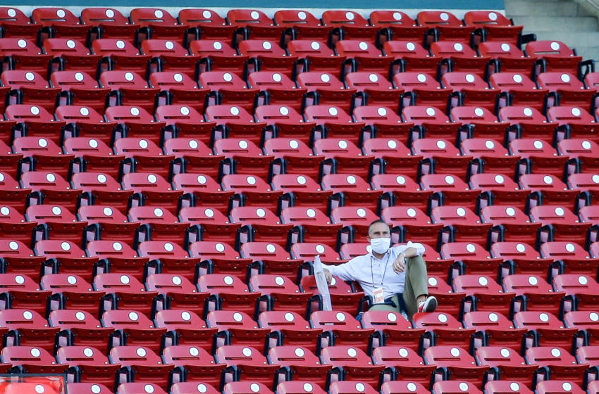 ST. LOUIS, MO - JULY 24: St. Louis Cardinals president of baseball operations John Mozeliak watches the Opening Day game between the St. Louis Cardinals and the Pittsburgh Pirates from the upper seats at Busch Stadium on July 24, 2020 in St. Louis, Missouri. The 2020 season had been postponed since March due to the COVID-19 pandemic. (Photo by Scott Kane/Getty Images)