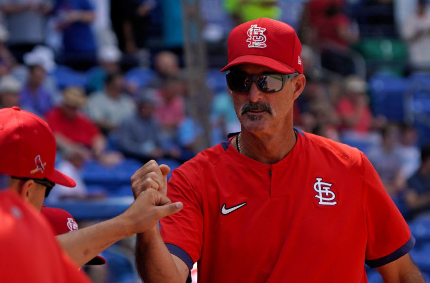 Mar 11, 2020; Port St. Lucie, Florida, USA; St. Louis Cardinals pitching coach Mike Mike Maddux greets players during a spring training game against the New York Mets at Clover Park. Mandatory Credit: Steve Mitchell-USA TODAY Sports