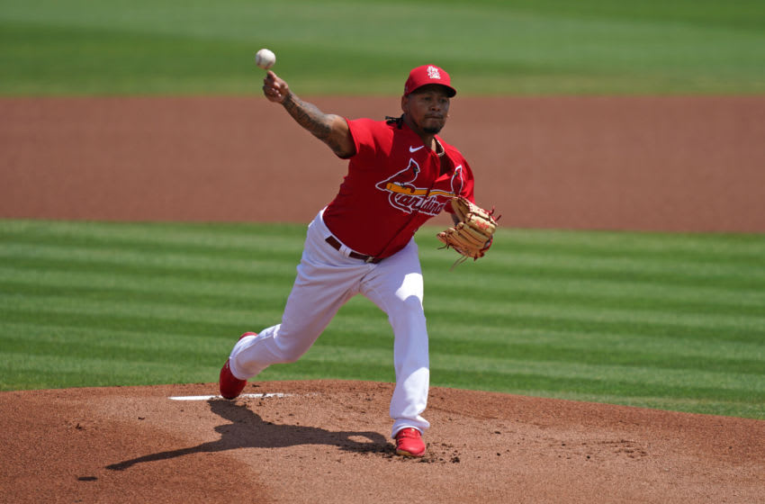 Carlos Martinez (18) delivers a pitch in the 1st inning of the spring training game against the New York Mets at Roger Dean Chevrolet Stadium. Mandatory Credit: Jasen Vinlove-USA TODAY Sports