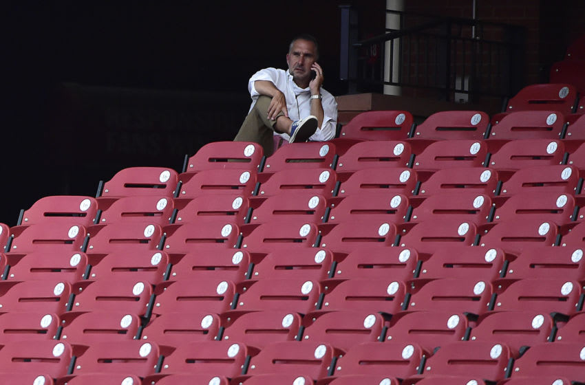 John Mozeliak looks on from the seats during workouts at Busch Stadium. Mandatory Credit: Jeff Curry-USA TODAY Sports