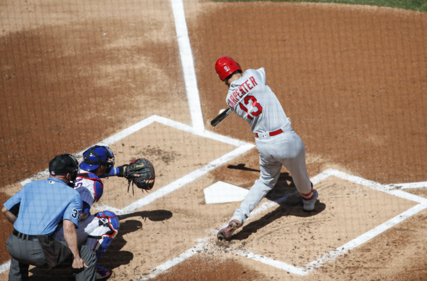 Matt Carpenter (13) hits a grand slam against the Chicago Cubs during the first inning at Wrigley Field. Mandatory Credit: Kamil Krzaczynski-USA TODAY Sports
