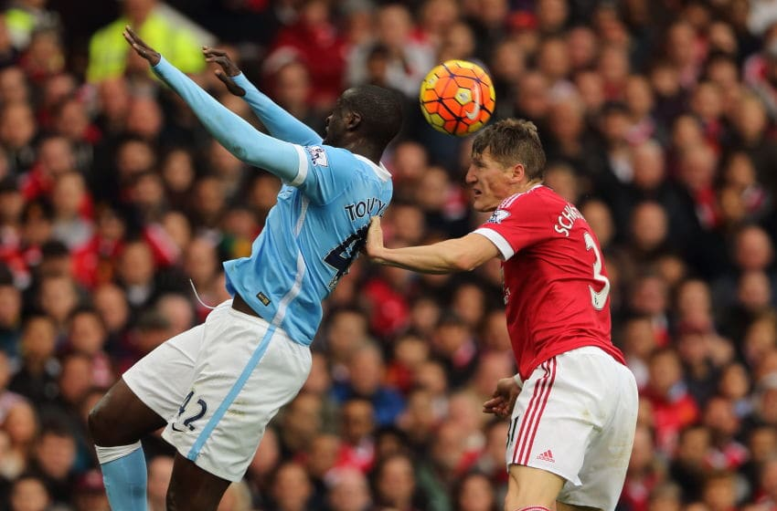 MANCHESTER, ENGLAND - OCTOBER 25: Yaya Toure of Manchester City and Bastian Schweinsteiger of Manchester United during the Barclays Premier League match between Manchester United and Manchester City at Old Trafford on October 25, 2015 in Manchester, England. (Photo by Matthew Ashton - AMA/Getty Images)