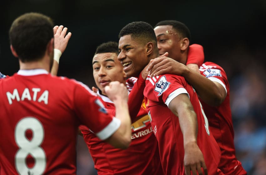 MANCHESTER, ENGLAND - MARCH 20: Marcus Rashford of Manchester United (2R) celebrates with team mates as he scores their first goal during the Barclays Premier League match between Manchester City and Manchester United at Etihad Stadium on March 20, 2016 in Manchester, United Kingdom. (Photo by Michael Regan/Getty Images)