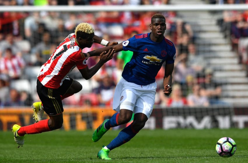 SUNDERLAND, ENGLAND - APRIL 09: Paul Pogba of Manchester United is challenged by Dider Ndong of Sunderland during the Premier League match between Sunderland and Manchester United at Stadium of Light on April 9, 2017 in Sunderland, England. (Photo by Stu Forster/Getty Images)
