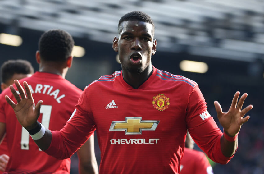 Manchester United's French midfielder Paul Pogba celebrates after he scores the team's first goal during the English Premier League football match between Manchester United and West Ham United at Old Trafford in Manchester, north west England, on April 13, 2019. (Photo by Paul ELLIS / AFP) / RESTRICTED TO EDITORIAL USE. No use with unauthorized audio, video, data, fixture lists, club/league logos or 'live' services. Online in-match use limited to 120 images. An additional 40 images may be used in extra time. No video emulation. Social media in-match use limited to 120 images. An additional 40 images may be used in extra time. No use in betting publications, games or single club/league/player publications. / (Photo credit should read PAUL ELLIS/AFP via Getty Images)