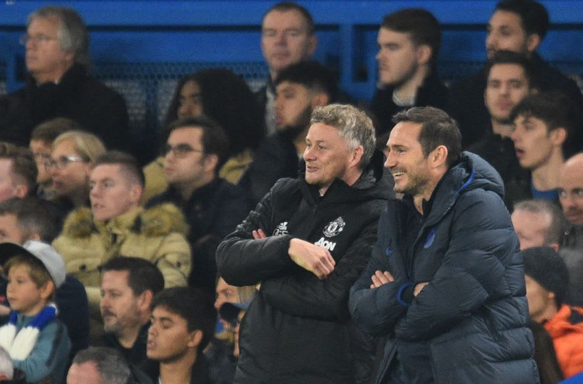 Manchester United's Norwegian manager Ole Gunnar Solskjaer (L) and Chelsea's English head coach Frank Lampard gesture during the English League Cup fourth round football match between Chelsea and Manchester United at Stamford Bridge in London on October 30, 2019. (Photo by Glyn KIRK / AFP) / RESTRICTED TO EDITORIAL USE. No use with unauthorized audio, video, data, fixture lists, club/league logos or 'live' services. Online in-match use limited to 75 images, no video emulation. No use in betting, games or single club/league/player publications. / (Photo by GLYN KIRK/AFP via Getty Images)