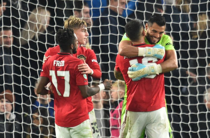 Manchester United's Argentinian goalkeeper Sergio Romero (R) and Manchester United's Argentinian defender Marcos Rojo gesture at the final whistle during the English League Cup fourth round football match between Chelsea and Manchester United at Stamford Bridge in London on October 30, 2019. (Photo by Glyn KIRK / AFP) / RESTRICTED TO EDITORIAL USE. No use with unauthorized audio, video, data, fixture lists, club/league logos or 'live' services. Online in-match use limited to 75 images, no video emulation. No use in betting, games or single club/league/player publications. / (Photo by GLYN KIRK/AFP via Getty Images)