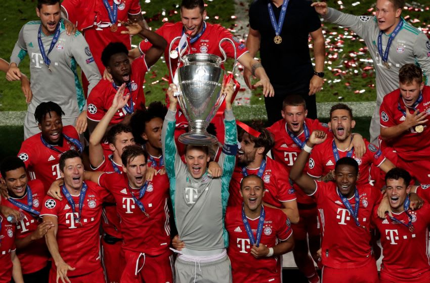 Bayern Munich's German goalkeeper Manuel Neuer (C) celebrates with teammates and the trophy after Bayern won the UEFA Champions League final football match between Paris Saint-Germain and Bayern Munich at the Luz stadium in Lisbon on August 23, 2020. (Photo by Manu Fernandez / POOL / AFP) (Photo by MANU FERNANDEZ/POOL/AFP via Getty Images)