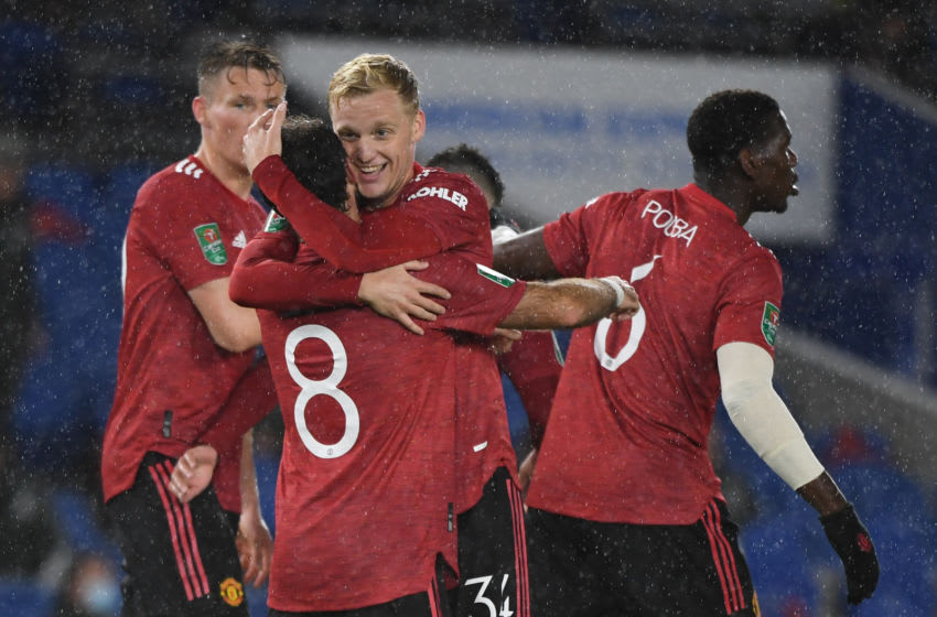 Manchester United's Spanish midfielder Juan Mata celebrates with teammates after he scores his team's second goal during the English League Cup fourth round football match between Brighton and Hove Albion and Manchester United at the American Express Community Stadium in Brighton, southern England on September 30, 2020. (Photo by Andy Rain / POOL / AFP) / RESTRICTED TO EDITORIAL USE. No use with unauthorized audio, video, data, fixture lists, club/league logos or 'live' services. Online in-match use limited to 120 images. An additional 40 images may be used in extra time. No video emulation. Social media in-match use limited to 120 images. An additional 40 images may be used in extra time. No use in betting publications, games or single club/league/player publications. / (Photo by ANDY RAIN/POOL/AFP via Getty Images)
