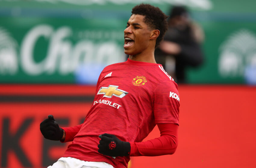 LEICESTER, ENGLAND - DECEMBER 26: Marcus Rashford of Manchester United celebrates scoring the opening goal during the Premier League match between Leicester City and Manchester United at The King Power Stadium on December 26, 2020 in Leicester, United Kingdom. The match will be played without fans, behind closed doors as a Covid-19 precaution. (Photo by Marc Atkins/Getty Images)