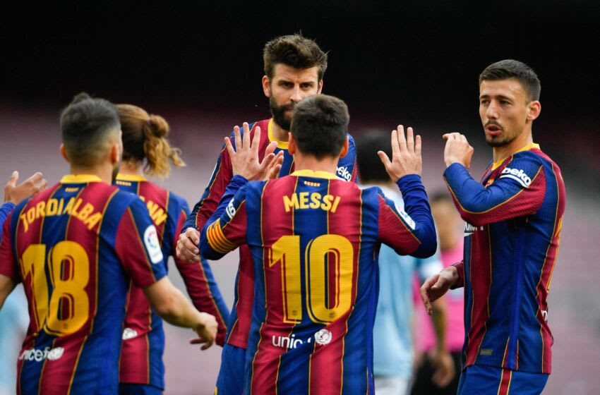 Barcelona's Argentinian forward Lionel Messi celebrates his goal with teammates during the Spanish League football match between FC Barcelona ans RC Celta de Vigo at the Camp Nou stadium in Barcelona on May 16, 2021. (Photo by Pau BARRENA / AFP) (Photo by PAU BARRENA/AFP via Getty Images)