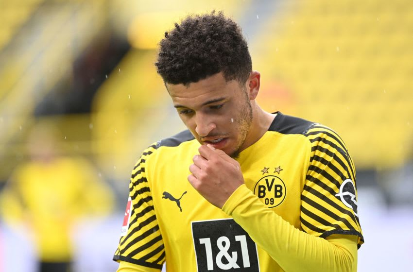 Dortmund's English midfielder Jadon Sancho reacts during the German first division Bundesliga football match Borussia Dortmund vs Bayer Leverkusen, in Dortmund on May 22, 2021. - DFL REGULATIONS PROHIBIT ANY USE OF PHOTOGRAPHS AS IMAGE SEQUENCES AND/OR QUASI-VIDEO (Photo by Ina FASSBENDER / POOL / AFP) / DFL REGULATIONS PROHIBIT ANY USE OF PHOTOGRAPHS AS IMAGE SEQUENCES AND/OR QUASI-VIDEO (Photo by INA FASSBENDER/POOL/AFP via Getty Images)