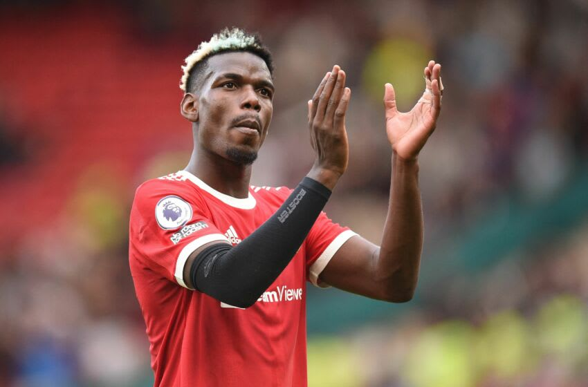 Manchester United's French midfielder Paul Pogba gestures as he leaves after the English Premier League football match between Manchester United and Newcastle at Old Trafford in Manchester, north west England, on September 11, 2021. - Manchester United won the game 4-1. - RESTRICTED TO EDITORIAL USE. No use with unauthorized audio, video, data, fixture lists, club/league logos or 'live' services. Online in-match use limited to 120 images. An additional 40 images may be used in extra time. No video emulation. Social media in-match use limited to 120 images. An additional 40 images may be used in extra time. No use in betting publications, games or single club/league/player publications. (Photo by Oli SCARFF / AFP) / RESTRICTED TO EDITORIAL USE. No use with unauthorized audio, video, data, fixture lists, club/league logos or 'live' services. Online in-match use limited to 120 images. An additional 40 images may be used in extra time. No video emulation. Social media in-match use limited to 120 images. An additional 40 images may be used in extra time. No use in betting publications, games or single club/league/player publications. / RESTRICTED TO EDITORIAL USE. No use with unauthorized audio, video, data, fixture lists, club/league logos or 'live' services. Online in-match use limited to 120 images. An additional 40 images may be used in extra time. No video emulation. Social media in-match use limited to 120 images. An additional 40 images may be used in extra time. No use in betting publications, games or single club/league/player publications. (Photo by OLI SCARFF/AFP via Getty Images)