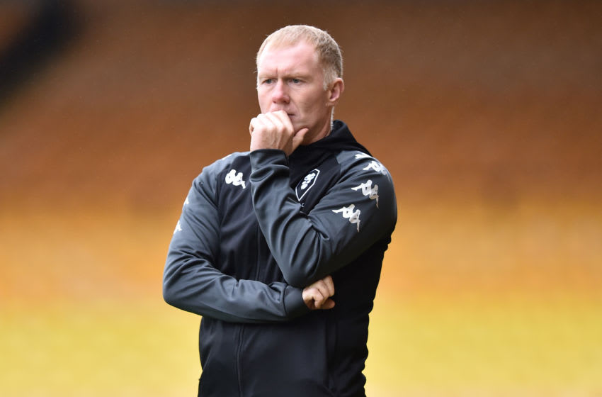 BURSLEM, ENGLAND - OCTOBER 17: Paul Scholes, interim manager and co owner of Salford City looks on during to the Sky Bet League Two match between Port Vale and Salford City at Vale Park on October 17, 2020 in Burslem, England. Sporting stadiums around the UK remain under strict restrictions due to the Coronavirus Pandemic as Government social distancing laws prohibit fans inside venues resulting in games being played behind closed doors. (Photo by Nathan Stirk/Getty Images)