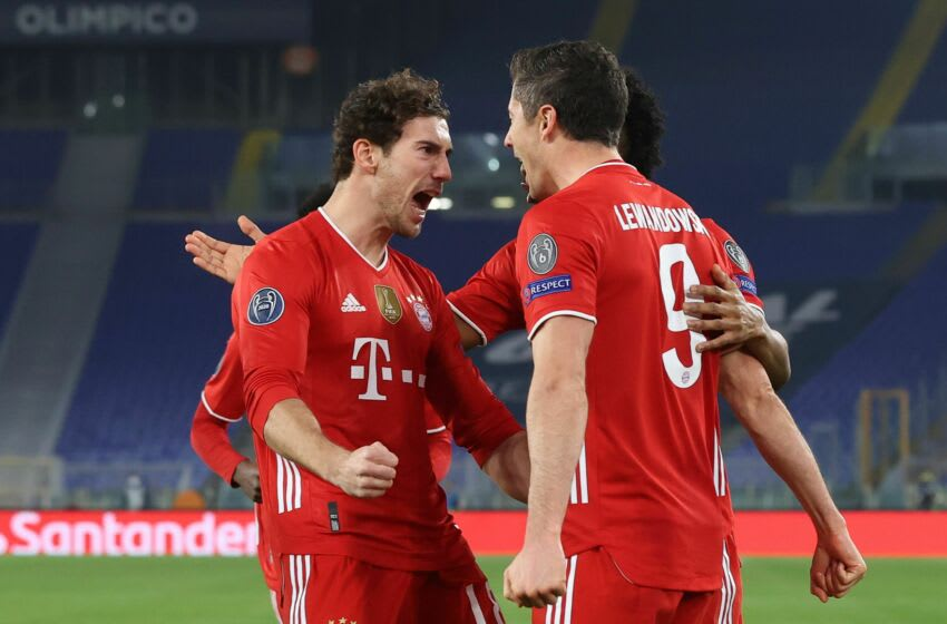 ROME, ITALY - FEBRUARY 23: Robert Lewandowski (R) of FC Bayern München celebrates scoring the first team goal with his team mate Leon Goretzka (L) during the UEFA Champions League Round of 16 match between Lazio Roma and Bayern München at Olimpico Stadium on February 23, 2021 in Rome, Italy. (Photo by Alexander Hassenstein/Getty Images)