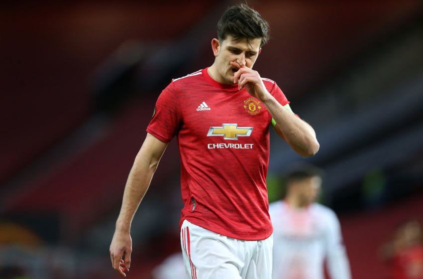 MANCHESTER, ENGLAND - MARCH 11: Harry Maguire of Manchester United looks dejected during the UEFA Europa League Round of 16 First Leg match between Manchester United and A.C. Milan at Old Trafford on March 11, 2021 in Manchester, England. Sporting stadiums around the UK remain under strict restrictions due to the Coronavirus Pandemic as Government social distancing laws prohibit fans inside venues resulting in games being played behind closed doors. (Photo by Alex Livesey - Danehouse/Getty Images)