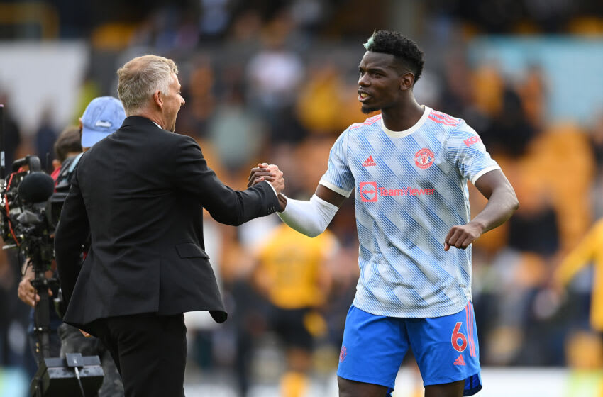 WOLVERHAMPTON, ENGLAND - AUGUST 29: Paul Pogba of Manchester United celebrates with Ole Gunnar Solskjaer, Manager of Manchester United following the Premier League match between Wolverhampton Wanderers and Manchester United at Molineux on August 29, 2021 in Wolverhampton, England. (Photo by Michael Regan/Getty Images)