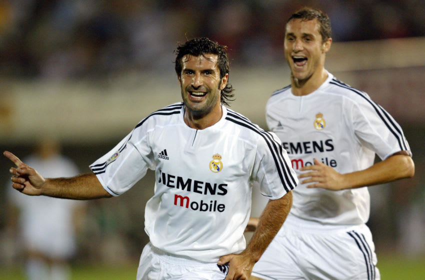 Real Madrid's Portuguese Luis Figo (L) celebrates after scoring their first goal during their Spanish Super Cup first leg match between Mallorca and Real Madrid at the Son Moix stadium of Palma de Mallorca, 24 August, 2003. AFP PHOTO/ Javier SORIANO. (Photo credit should read JAVIER SORIANO/AFP via Getty Images)