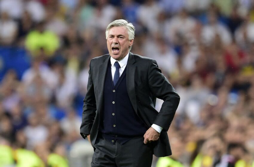 Real Madrid's Italian coach Carlo Ancelotti gestures during the Spanish league football match Real Madrid CF vs Valencia CF at the Santiago Bernabeu stadium in Madrid on May 9, 2015. The game ended with a draw 2-2. AFP PHOTO/ GERARD JULIEN (Photo credit should read GERARD JULIEN/AFP via Getty Images)