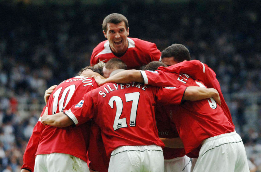 Newcastle upon Tyne, UNITED KINGDOM: Manchester United's captaian Roy Keane dives over as the team celebrates Ruud van Nistelrooy's goal against Newcastle United during their Premiereship match at St James' Park, in Newcastle, 28 August 2005. AFP PHOTO Paul Barker Mobile and website use of domestic English football pictures subject to subscription of a license with Football Association Premier League (FAPL) tel : +44 207 298 1656. For newspapers where the football content of the printed and electronic versions are (Photo credit should read PAUL BARKER/AFP via Getty Images)