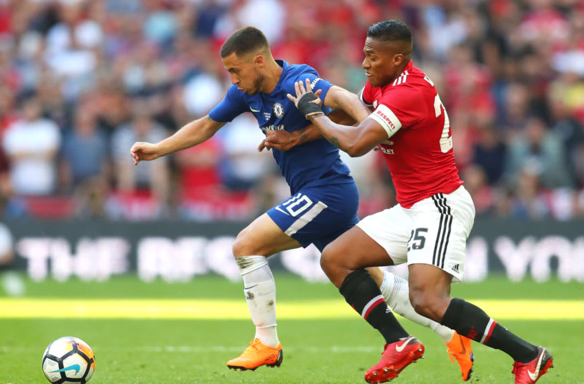 LONDON, ENGLAND - MAY 19: Eden Hazard of Chelsea is challenged by Antonio Valencia of Manchester United during The Emirates FA Cup Final between Chelsea and Manchester United at Wembley Stadium on May 19, 2018 in London, England. (Photo by Catherine Ivill/Getty Images)