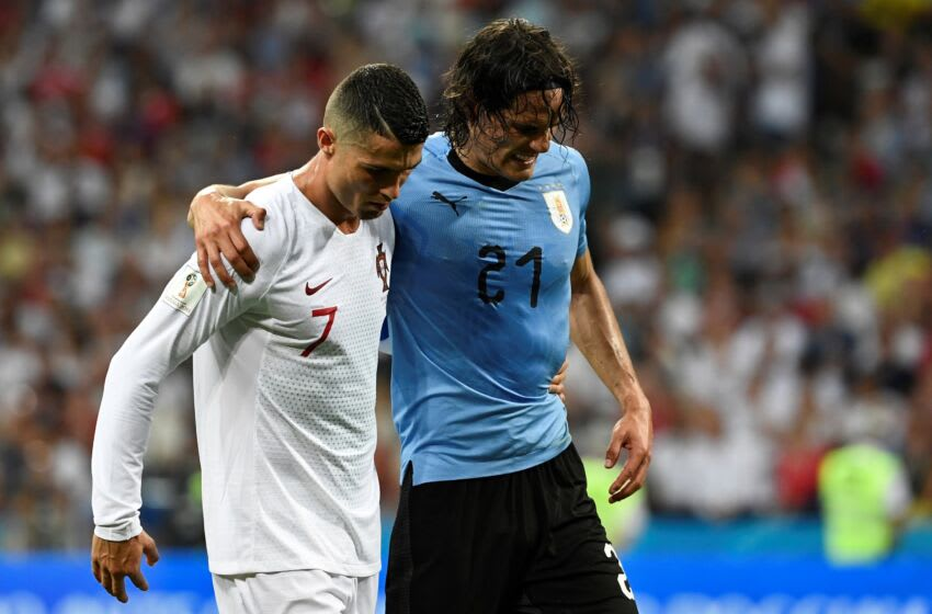 Uruguay's forward Edinson Cavani (2ndL) leaves the pitch comforted by Portugal's forward Cristiano Ronaldo during the Russia 2018 World Cup round of 16 football match between Uruguay and Portugal at the Fisht Stadium in Sochi on June 30, 2018. (Photo by Jonathan NACKSTRAND / AFP) / RESTRICTED TO EDITORIAL USE - NO MOBILE PUSH ALERTS/DOWNLOADS (Photo credit should read JONATHAN NACKSTRAND/AFP via Getty Images)