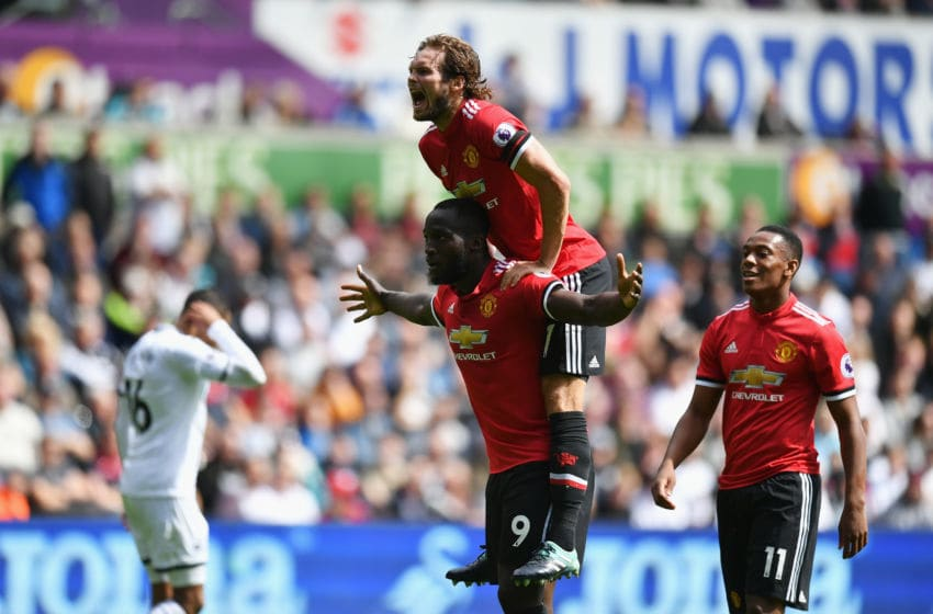 SWANSEA, WALES - AUGUST 19: Romelu Lukaku of Manchester United celebrates scoring hisw sides second goal with Daley Blind of Manchester United during the Premier League match between Swansea City and Manchester United at Liberty Stadium on August 19, 2017 in Swansea, Wales. (Photo by Dan Mullan/Getty Images)