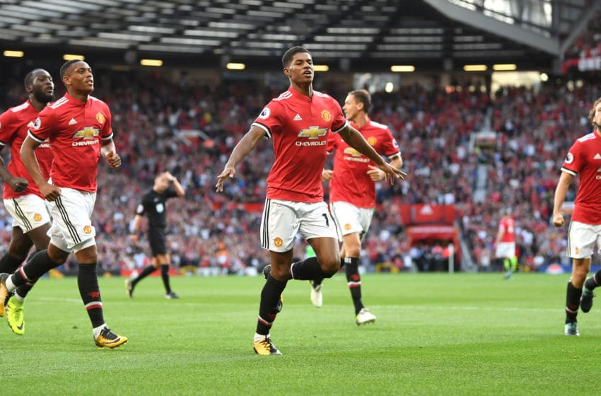 MANCHESTER, ENGLAND - AUGUST 26: Marcus Rashford of Manchester United celebrates scoring his sides first goal with his Manchester United team mates during the Premier League match between Manchester United and Leicester City at Old Trafford on August 26, 2017 in Manchester, England. (Photo by Michael Regan/Getty Images)