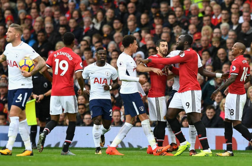 MANCHESTER, UNITED KINGDOM - OCTOBER 28: Dele Alli of Tottenham Hotspur and Romelu Lukaku of Manchester United clash during the Premier League match between Manchester United and Tottenham Hotspur at Old Trafford on October 28, 2017 in Manchester, England. (Photo by Michael Regan/Getty Images)
