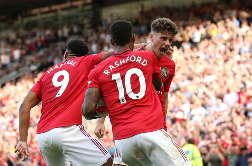 MANCHESTER, ENGLAND - AUGUST 24: Daniel James of Manchester United celebrates scoring his team's first goal with Anthony Martial and Marcus Rashford during the Premier League match between Manchester United and Crystal Palace at Old Trafford on August 24, 2019 in Manchester, United Kingdom. (Photo by Jan Kruger/Getty Images)