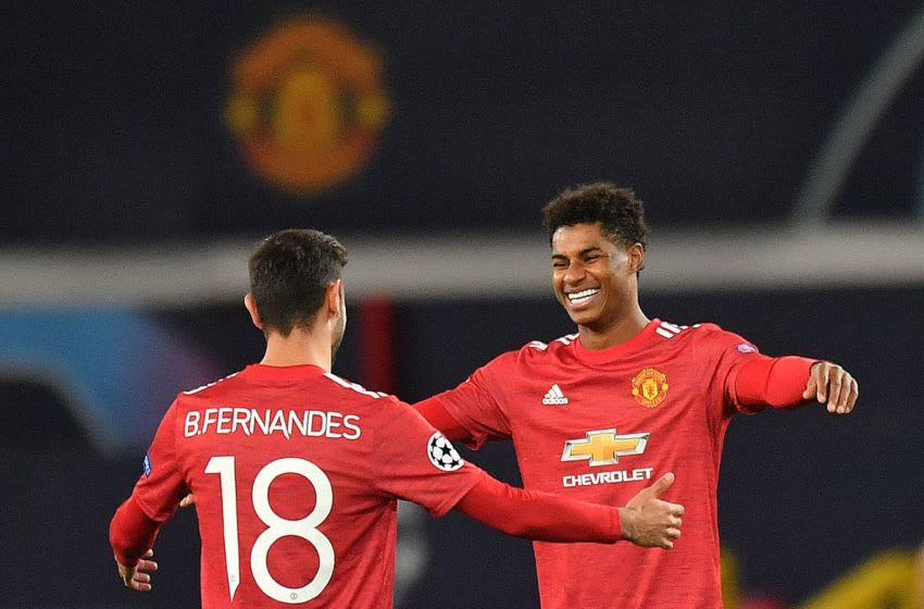 Manchester United's English striker Marcus Rashford (R) celebrates scoring his team's third goal, his second, with Manchester United's Portuguese midfielder Bruno Fernandes, during the UEFA Champions league group H football match between Manchester United and RB Leipzig at Old Trafford stadium in Manchester, north west England, on October 28, 2020. (Photo by Anthony Devlin / AFP) (Photo by ANTHONY DEVLIN/AFP via Getty Images)