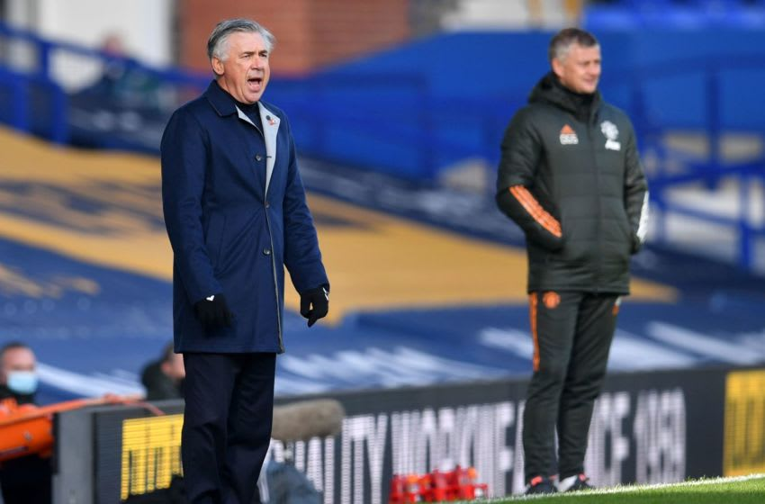 Everton's Italian head coach Carlo Ancelotti (L) and Manchester United's Norwegian manager Ole Gunnar Solskjaer watches his players from the touchline during the English Premier League football match between Everton and Manchester United at Goodison Park in Liverpool, north west England on November 7, 2020. (Photo by Paul ELLIS / POOL / AFP) / RESTRICTED TO EDITORIAL USE. No use with unauthorized audio, video, data, fixture lists, club/league logos or 'live' services. Online in-match use limited to 120 images. An additional 40 images may be used in extra time. No video emulation. Social media in-match use limited to 120 images. An additional 40 images may be used in extra time. No use in betting publications, games or single club/league/player publications. / (Photo by PAUL ELLIS/POOL/AFP via Getty Images)