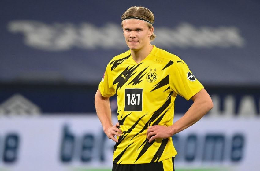 Dortmund's Norwegian forward Erling Braut Haaland reacts during the German first division Bundesliga football match FC Schalke 04 vs Borussia Dortmund in Gelsenkirchen, western Germany, on February 20, 2021. (Photo by Ina Fassbender / various sources / AFP) / RESTRICTIONS: DFL REGULATIONS PROHIBIT ANY USE OF PHOTOGRAPHS AS IMAGE SEQUENCES AND/OR QUASI-VIDEO (Photo by INA FASSBENDER/AFP via Getty Images)