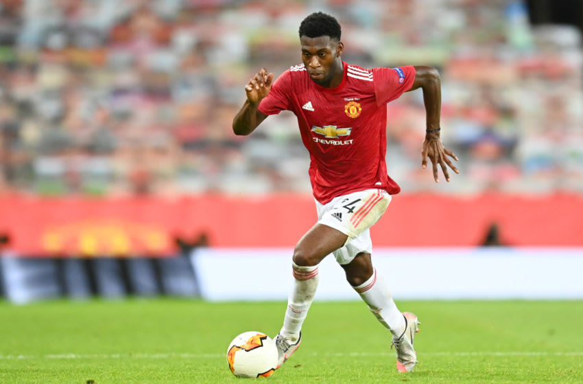MANCHESTER, ENGLAND - AUGUST 05: Timothy Fosu-Mensah of Manchester United in action during the UEFA Europa League round of 16 second leg match between Manchester United and LASK at Old Trafford on August 05, 2020 in Manchester, England. (Photo by Michael Regan/Getty Images)