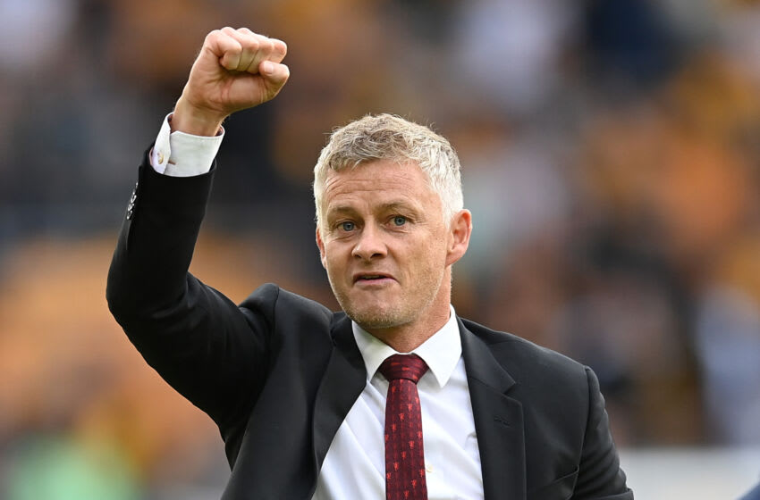 WOLVERHAMPTON, ENGLAND - AUGUST 29: Ole Gunnar Solskjaer, Manager of Manchester United celebrates following the Premier League match between Wolverhampton Wanderers and Manchester United at Molineux on August 29, 2021 in Wolverhampton, England. (Photo by Michael Regan/Getty Images)