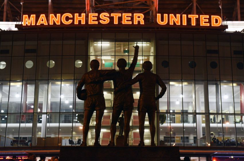 A general view outside Old Trafford stadium and 'The United Trinity' statue of former Manchester United players George Best, Denis Law, and Bobby Charlton seen ahead of the English Premier League football match between Manchester United and Burnley at Old Trafford in Manchester, north west England, on February 11, 2015. AFP PHOTO / OLI SCARFF RESTRICTED TO EDITORIAL USE. No use with unauthorized audio, video, data, fixture lists, club/league logos or live services. Online in-match use limited to 45 images, no video emulation. No use in betting, games or single club/league/player publications. (Photo credit should read OLI SCARFF/AFP via Getty Images)