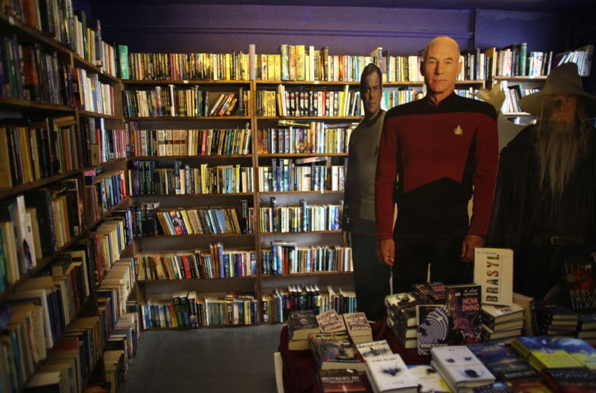 HAY-ON-WYE, WALES - MAY 31: Cardboard cut outs of Star Trek actors stand next to a selection of second hand books in a bookshop during the Hay Festival on May 31, 2011 in Hay-on-Wye, Wales. The small Welsh town is famous for it's books and bookshops and the annual Hay Festival attracts some of the world's best authors, poets and artists. (Photo by Christopher Furlong/Getty Images)